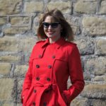 What Lizzy Loves wears red trench coat and Feb 31st eyewear