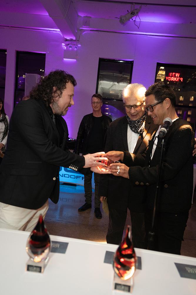Award organizer Maarten Weidema from TEF Magazine offering the TEFFIE to winner Blake Kuwahara